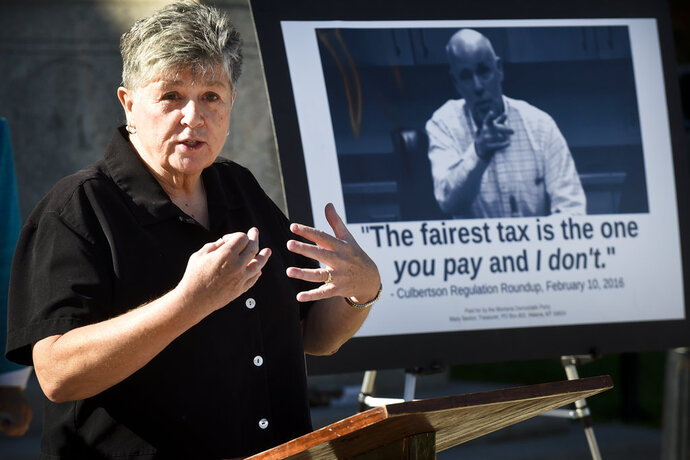 FILE - In this Sept. 29, 2016, file photo, Chairwoman of the Montana Democratic Party Nancy Keenan talks about then Republican gubernatorial candidate Greg Gianforte during a news conference on the steps of the State Capitol in Helena, Mont. The head of the Montana Democratic Party said this week that the Montana Legislature must close a loophole in the state's campaign finance law that allowed an anonymous person or group to bankroll the signature-gathering effort that qualified the Montana Green Party for the 2018 ballot. (Thom Bridge /Independent Record via AP, File)