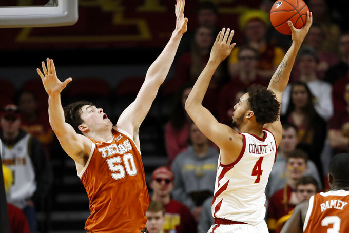 Iowa State forward George Conditt IV shoots over Texas center Will Baker, left, during the second half of an NCAA college basketball game, Saturday, Feb. 15, 2020, in Ames, Iowa. Iowa State won 81-52. (AP Photo/Charlie Neibergall)