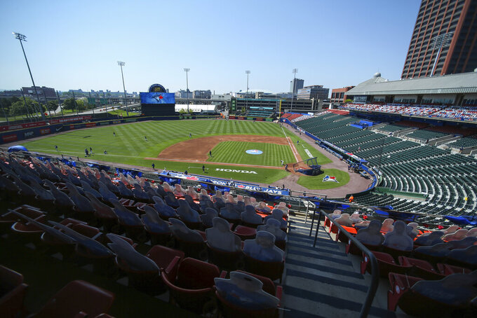 Fan cutouts fill seats of the upper level of Sahlen Field as the Toronto Blue Jays and Houston Astros warm up before a baseball game in Buffalo, N.Y., Sunday, June 6, 2021. (AP Photo/Joshua Bessex)