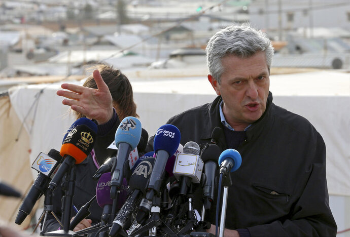 """U.N. refugee chief Filippo Grandi speaks to the press during a visit to the Zaatari Syrian Refugee Camp, in Mafraq, Jordan, Monday, Feb. 12, 2018. Grandi said the number of Syrian refugees deported from Jordan to their war-ravaged homeland has """"decreased dramatically"""" in recent months, in part because of appeals for more careful reviews of cases. (AP Photo/Raad Adayleh)"""