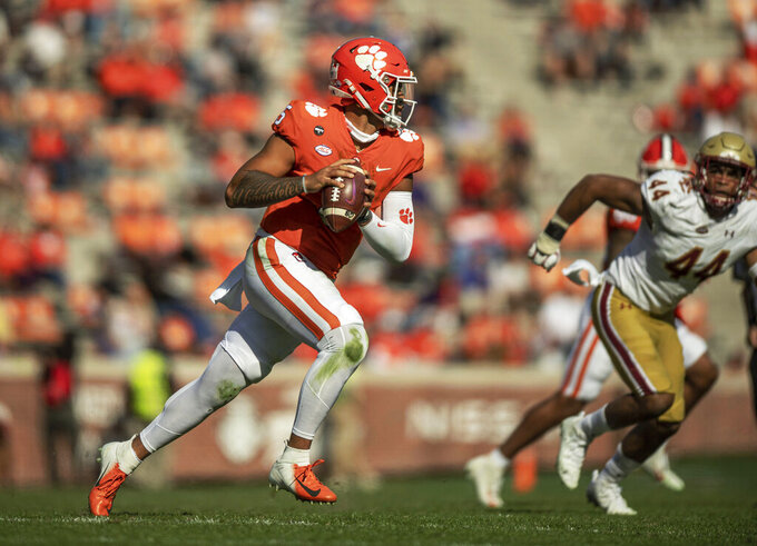 Clemson quarterback D.J. Uiagalelei (5) runs during the first half of an NCAA college football game against Boston College  Saturday, Oct. 31, 2020, in Clemson, S.C. (Josh Morgan/Pool Photo via AP)
