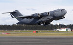 A U.S. Air Force C-17 takes off from Christchurch Airport in the season's first flight to McMurdo Station in Antarctica, Monday, Sept. 14, 2020. The first U.S. flight into Antarctica following months of winter darkness left from New Zealand Monday with crews extra vigilant about keeping out the coronavirus. (AP Photo/Mark Baker)