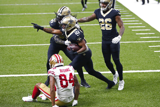 New Orleans Saints cornerback Patrick Robinson (21) celebrates his interception, intended for San Francisco 49ers wide receiver Kendrick Bourne (84), in the end zone in the second half of an NFL football game in New Orleans, Sunday, Nov. 15, 2020. The Saints won 27-13. (AP Photo/Brett Duke)
