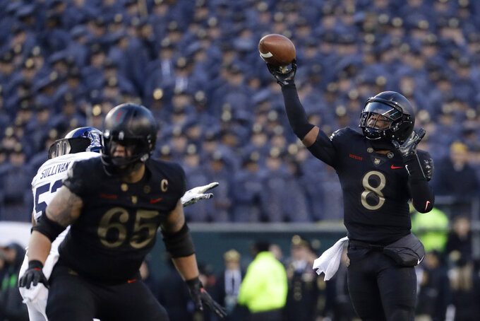 Army's Kelvin Hopkins Jr. throws a pass during the first half of an NCAA college football game against Navy, Saturday, Dec. 8, 2018, in Philadelphia. (AP Photo/Matt Slocum)