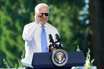 President Joe Biden puts on his sunglasses toward the end of a news conference after meeting with Russian President Vladimir Putin, Wednesday, June 16, 2021, in Geneva, Switzerland. (AP Photo/Patrick Semansky)