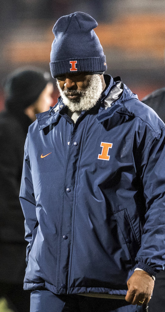 Illinois head coach Lovie Smith leaves the field after his team was defeated 63-0 by Iowa in an NCAA college football game, Saturday, Nov. 17, 2018, in Champaign, Ill. (AP Photo/Holly Hart)