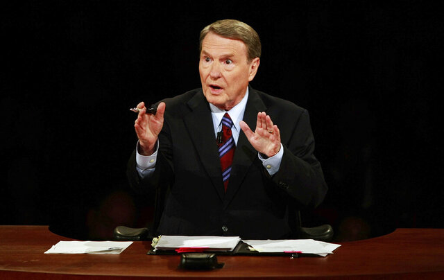 FILE - This Sept. 26, 2008 file photo shows debate moderator Jim Lehrer during the first U.S. Presidential Debate between presidential nominees Sen. John McCain, R-Ariz., and Sen. Barack Obama, D-Ill., at the University of Mississippi in Oxford, Miss.  PBS announced that PBS NewsHour's Jim Lehrer died Thursday, Jan. 23, 2020, at home. He was 85. (AP Photo/Chip Somodevilla, File)
