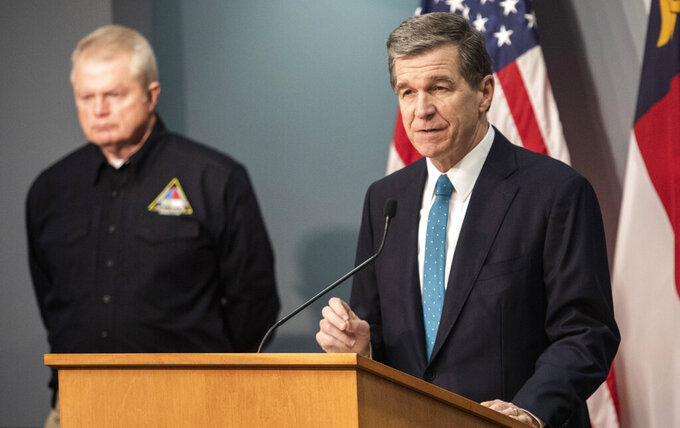 Gov. Roy Cooper speaks during a briefing on North Carolina's coronavirus pandemic response Thursday, April 9, 2020 at the NC Emergency Operations Center in Raleigh, N.C. Cooper issued an executive order requiring retail stores to implement social distancing measures. (Travis Long/The News & Observer via AP)