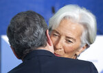 Outgoing European Central Bank President Mario Draghi greets his designated successor Christine Lagarde, at a ceremony celebrating the change at the head of the ECB in Frankfurt, Germany, Monday, Oct. 28, 2019. Draghi leaves as head of the European Central Bank credited with having rescued the eurozone from disaster with a well-timed phrase and bold action to back up his words. (Boris Roessler/Pool Photo via AP)