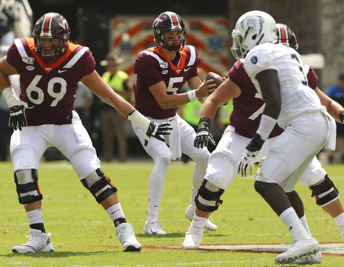 Virginia Tech quarterback Ryan Willis (5) looks downfield  during the second half of an NCAA college football game against Old Dominion in Blacksburg Va,. Saturday, Sept. 7, 2019. (Matt Gentry/The Roanoke Times via AP)