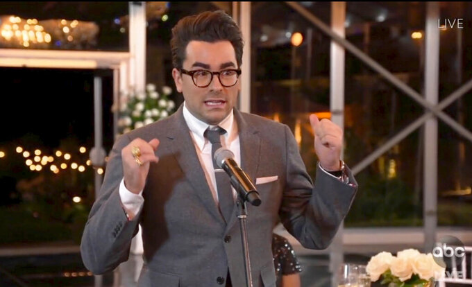"""In this video grab captured on Sept. 20, 2020, courtesy of the Academy of Television Arts & Sciences and ABC Entertainment, Daniel Levy accepts the award for outstanding supporting actor in a comedy series for """"Schitt's Creek"""" during the 72nd Emmy Awards broadcast. (The Television Academy and ABC Entertainment via AP)"""