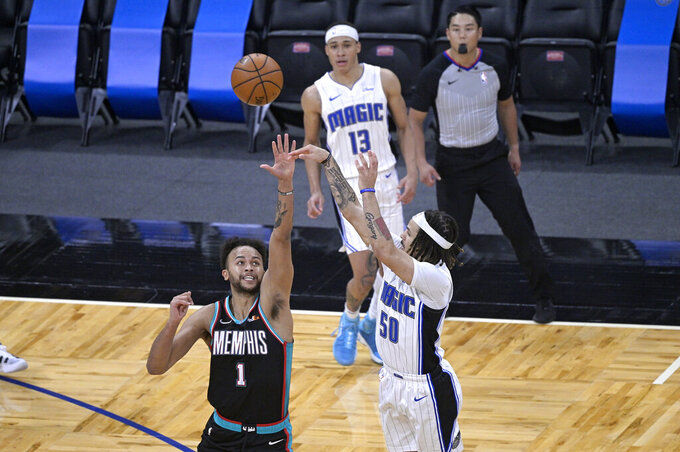 Orlando Magic guard Cole Anthony (50) hits the winning basket in front of Memphis Grizzlies forward Kyle Anderson (1) during the second half of an NBA basketball game, Saturday, May 1, 2021, in Orlando, Fla. (AP Photo/Phelan M. Ebenhack)