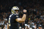 FILE - In this Dec. 23, 2018, file photo, New Orleans Saints quarterback Drew Brees reacts after a touchdown carry by running back Alvin Kamara, not pictured, in the first half of an NFL football game against the Pittsburgh Steelers, in New Orleans. The NFC South's reputation as the NFL's most balanced division has taken a hit. The New Orleans Saints' two-year run as division champion, including a dominant showing in 2018, has left other teams eager to prove there is still parity in the South.  (AP Photo/Butch Dill, File)