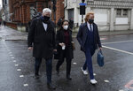 Wikileaks spokesman Kristinn Hrafnsson, left, with Stella Moris girlfriend of Julian Assange, center, and Joseph A Farrell of Wikileaks walk towards Westminster Magistrates Court for his Bail hearing in London, Wednesday, Jan. 6, 2021. On Monday Judge Vanessa Baraitser ruled that Julian Assange cannot be extradited to the US. because of concerns about his mental health. Assange had been charged under the US's 1917 Espionage Act for