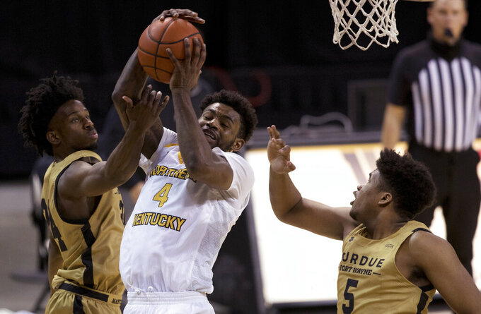 Northern Kentucky forward Adrian Nelson (4) grabs a rebound next to Purdue-Fort Wayne guard DeMierre Black (24) and forward Johnathan DeJurnett (5) during the first half of an NCAA college basketball game Friday, Jan. 1, 2021, in Highland Heights, Ky. (Albert Cesare/The Cincinnati Enquirer via AP)