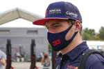 Red Bull driver Max Verstappen of the Netherlands arrives to attend the first practice session for Sunday's Italian Formula One Grand Prix, at the Monza racetrack, in Monza, Italy, Friday, Sept. 10, 2021. (AP Photo/Luca Bruno)