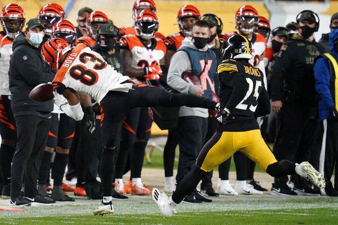 Cincinnati Bengals wide receiver Tyler Boyd (83) cannot come up with the catch on a pass from quarterback Joe Burrow with Pittsburgh Steelers safety Antoine Brooks Jr. (25) defending during the second half of an NFL football game, Sunday, Nov. 15, 2020, in Pittsburgh. (AP Photo/Keith Srakocic)