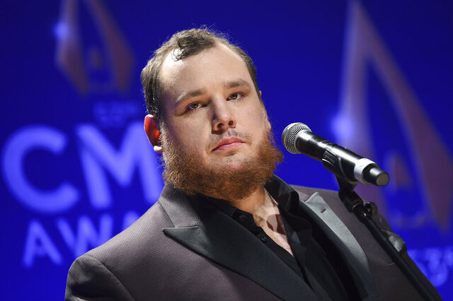 FILE - Singer-songwriter Luke Combs speaks in the press room after winning awards for male vocalist of the year and song of the year at the 53rd annual CMA Awards at Bridgestone Arena, in this Wednesday, Nov. 13, 2019, file photo. NASCAR will attempt some normalcy at the season-opening Daytona 500 with a live pre-race concert featuring country music star Luke Combs. (Photo by Evan Agostini/Invision/AP, File)