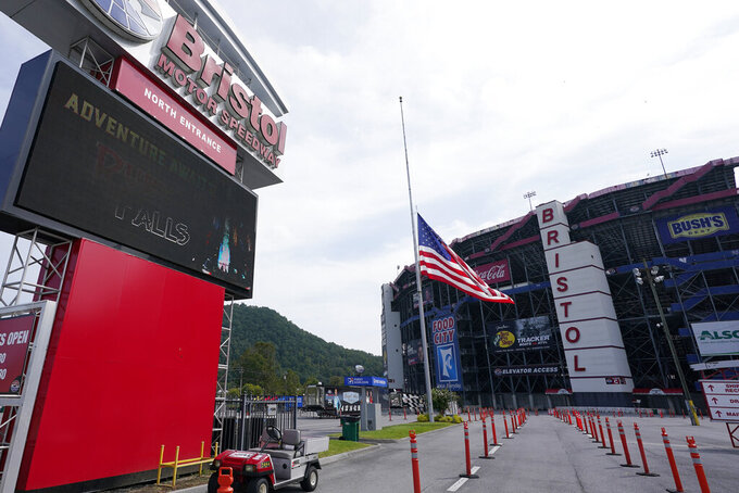The entrance to the Bristol Motor Speedway flies the U.S. Flag at half staff in honor of the late Supreme Court Justice Ruth Bader Ginsburg, Saturday, Sept. 19, 2020, in Bristol, Tenn. (AP Photo/Steve Helber)