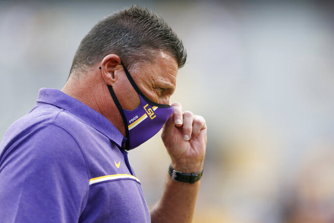 LSU head coach Ed Orgeron watches the team warm up before taking on South Carolina in an NCAA college football game in Baton Rouge, La. Saturday, Oct. 24, 2020. (AP Photo/Brett Duke)