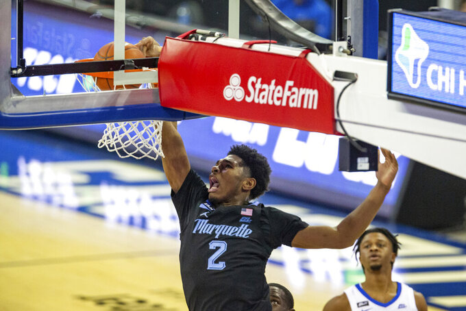 Marquette forward Justin Lewis (2) makes a dunk against Creighton in the first half during an NCAA basketball game on Monday, Dec. 14, 2020, in Omaha, Neb. (AP Photo/John Peterson)