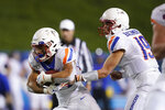Boise State quarterback Hank Bachmeier (19) hands off to running back George Holani (24) against San Jose State during the second half of an NCAA college football game, in San Jose, Calif., Saturday, Nov. 2, 2019. (AP Photo/Tony Avelar)