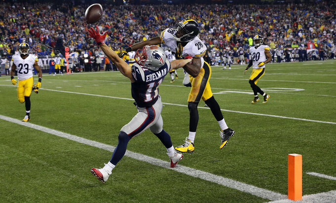 FILE - In this Sept. 10, 2015, file photo, New England Patriots wide receiver Julian Edelman (11) cannot catch a pass in the end zone as Pittsburgh Steelers cornerback Cortez Allen (28) defends in the second half of an NFL football game in Foxborough, Mass. Citing a knee injury that cut his 2020 season short after just six games, Edelman announced Monday, April 12, 2021, that he is retiring from the NFL after 11 seasons. (AP Photo/Charles Krupa, File)