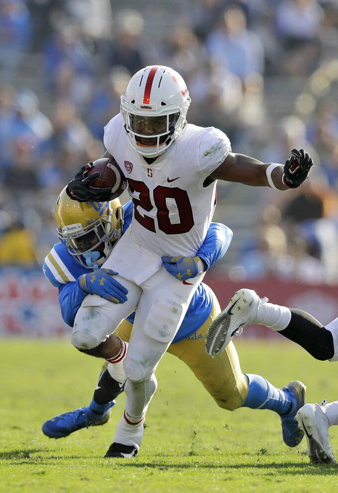 Stanford running back Bryce Love (20) is tackled by UCLA linebacker Tyree Thompson during the second half of an NCAA college football game Saturday, Nov. 24, 2018, in Pasadena, Calif. (AP Photo/Marcio Jose Sanchez)