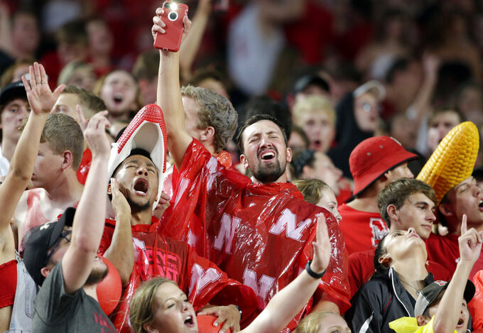 Fans at Memorial Stadium sing along to music played during a lightning delay in the first half of an NCAA college football game between Nebraska and Akron in Lincoln, Neb., Saturday, Sept. 1, 2018. (AP Photo/Nati Harnik)