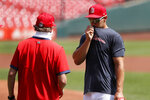 St. Louis Cardinals' Paul Goldschmidt, right, talks with manager Mike Shildt during baseball practice at Busch Stadium Sunday, July 5, 2020, in St. Louis. (AP Photo/Jeff Roberson)