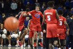 SMU guard Grant Youngkin, center, and forward Isiaha Mike, left, celebrate in the second half of an NCAA basketball game against Memphis Saturday, Jan. 25, 2020, in Memphis, Tenn. (AP Photo/Brandon Dill)