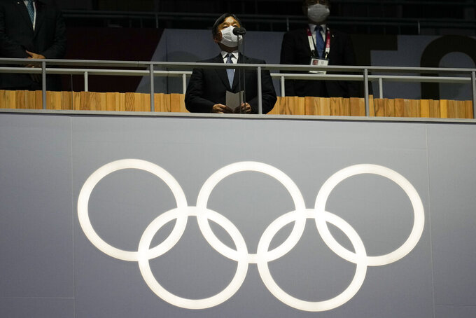 """FILE - In this July 23, 2021, file photo, Japan's Emperor Naruhito addresses the opening ceremony in the Olympic Stadium at the 2020 Summer Olympics, in Tokyo, Japan. When the Tokyo Olympics began during a worsening pandemic, the majority of the host nation was in opposition, with Emperor Naruhito dropping the word """"celebrating"""" from his opening declaration of welcome. But once the Games got underway and local media switched to covering Japanese athletes' """"medal rush,"""" many were won over.  (AP Photo/Natacha Pisarenko, File)"""