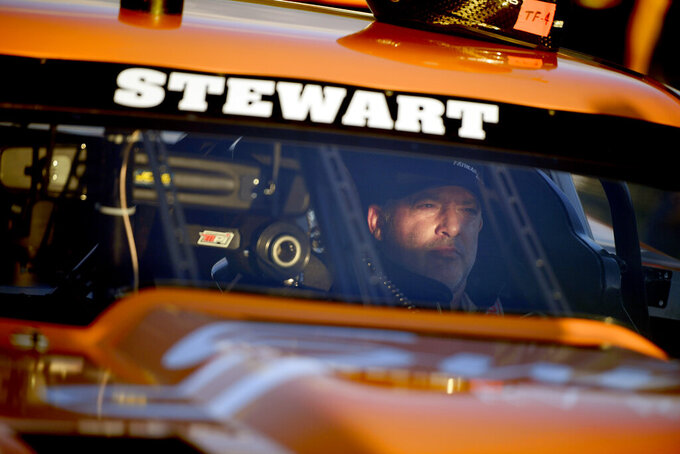Tony Stewart sits in his car during the debut race of Superstar Racing Experience (SRX) at Stafford Motor Speedway, Saturday, June 12, 2021, in Stafford, Conn. (AP Photo/Jessica Hill)