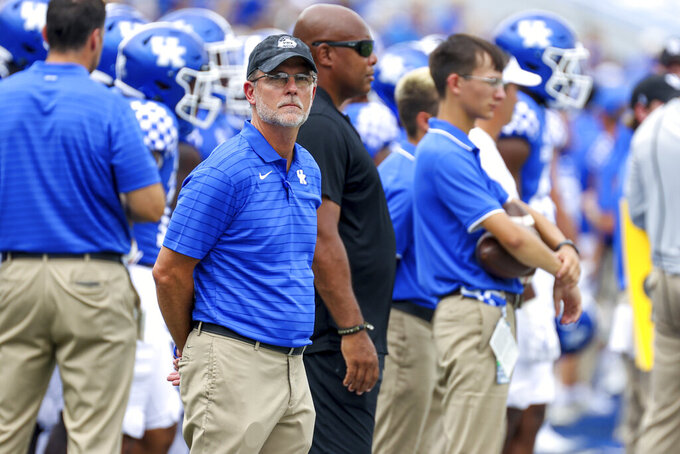 Kentucky's special assistant to the head coach Eddie Gran, front, looks up at the video board during the first half of a NCAA college football game against Chattanooga in Lexington, Ky., Saturday, Sept. 18, 2021. (AP Photo/Michael Clubb)