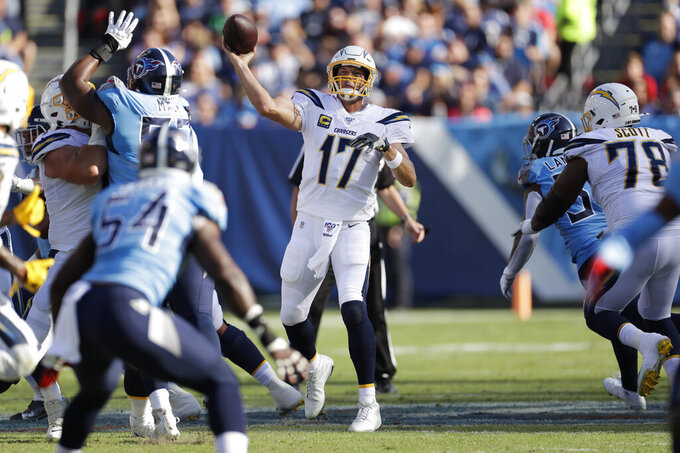 Los Angeles Chargers quarterback Philip Rivers (17) passes against the Tennessee Titans in the first half of an NFL football game Sunday, Oct. 20, 2019, in Nashville, Tenn. (AP Photo/James Kenney)