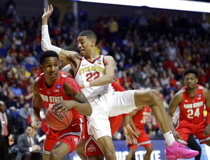 Ohio State's C.J. Jackson, left, comes away with a rebound alongside Iowa State's Tyrese Haliburton (22) during the first half of a first round men's college basketball game in the NCAA Tournament Friday, March 22, 2019, in Tulsa, Okla. (AP Photo/Jeff Roberson)