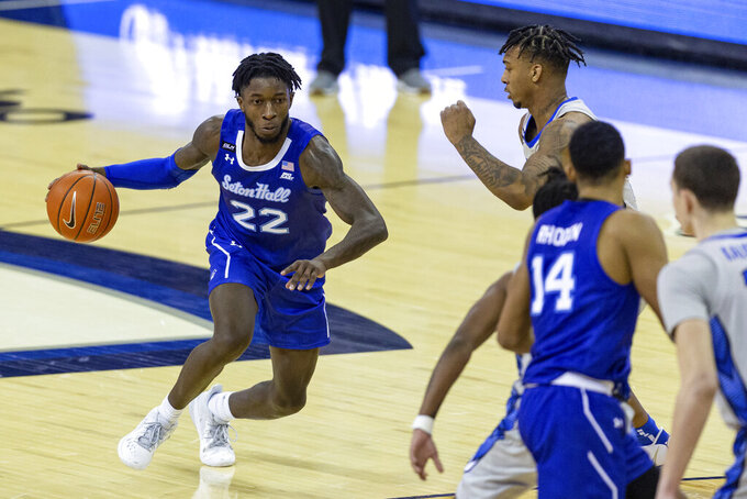 Seton Hall guard Myles Cale (22) drives as Creighton guard Antwann Jones (0) defends during the second half of an NCAA college basketball game Wednesday, Jan. 6, 2021, in Omaha, Neb. (AP Photo/John Peterson)