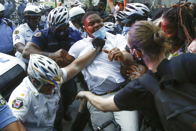 Philadelphia police, left, confront protesters during the Justice for George Floyd Philadelphia Protest on Saturday, May 30, 2020. Floyd died in Minneapolis police custody on Memorial Day, after an officer pressed his knee into his neck for several minutes even after he stopped moving and pleading for air. (AP Photo/Matt Rourke)