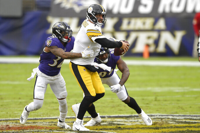Baltimore Ravens free safety DeShon Elliott (32) and defensive end Yannick Ngakoue (91) apply pressure on Pittsburgh Steelers quarterback Ben Roethlisberger (7) during the first half of an NFL football game, Sunday, Nov. 1, 2020, in Baltimore. (AP Photo/Nick Wass)