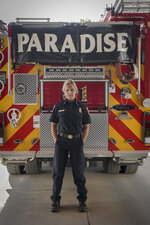 This image released by National Geographic shows firefighter Shawna Powell posing in front of a Paradise Fire Department fire truck in Paradise, Calif., for the documentary