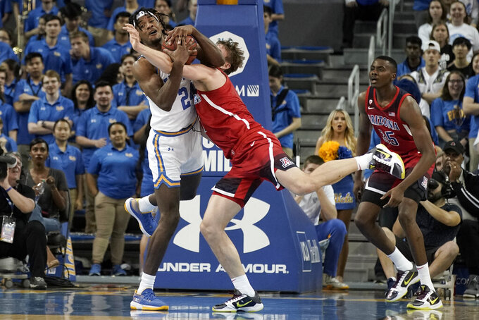 UCLA forward Jalen Hill, left, battles Arizona forward Stone Gettings for a rebound during the first half of an NCAA college basketball game in Los Angeles, Saturday, Feb. 29, 2020. (AP Photo/Chris Carlson)