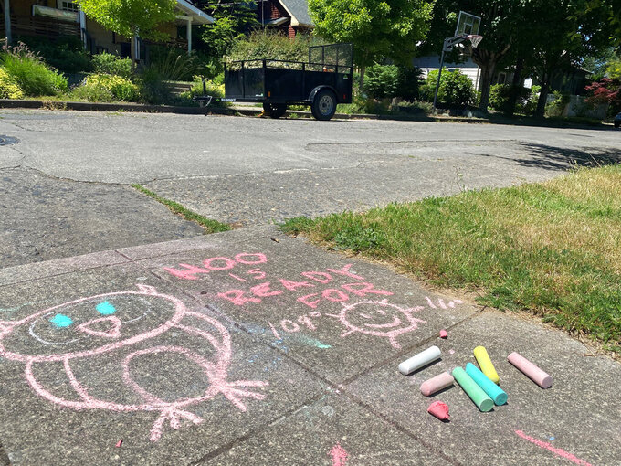 A chalk drawing on the sidewalk in a residential neighborhood in Southeast Portland, Ore., Friday, June 25, 2021, represents a funny take on how hot the temperature is supposed to be during the weekend. The Pacific Northwest sweltered Friday as a historic heat wave hit Washington and Oregon, with temperatures in many areas expected to top out 25 to 30 degrees above normal in the coming days. (AP Photo/Sara Cline)