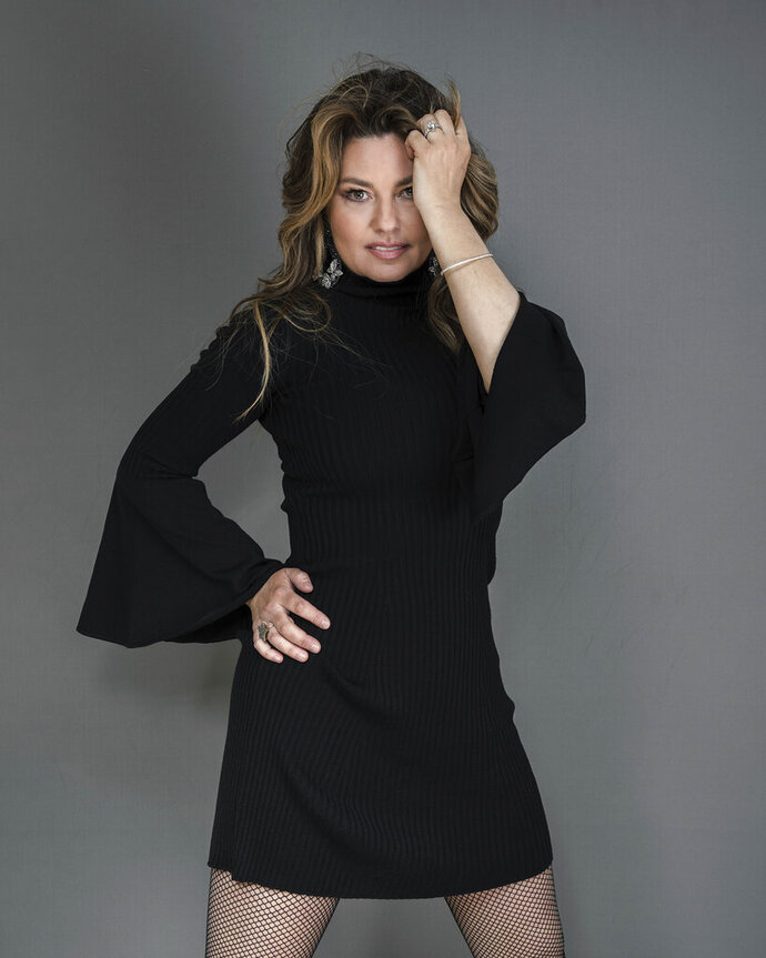 """FILE - Shania Twain appears during a portrait session in New York on  June 14, 2019. Twain is celebrating the 25th anniversary of the album that turned her into a global superstar. She is releasing a deluxe reissue set of her 1995 breakthrough album """"The Woman in Me,"""" which became the best-selling record by a woman in country music at the time. (Photo by Christopher Smith/Invision/AP, File)"""