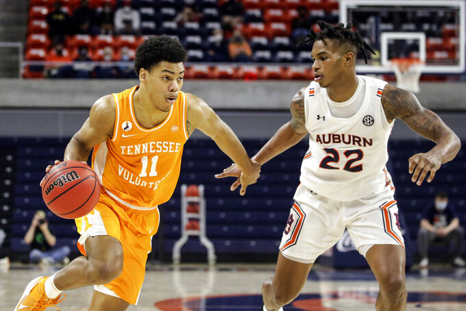 Tennessee guard Jaden Springer (11) drives to the basket as Auburn guard Allen Flanigan (22) defends during the second half of an NCAA basketball game Saturday, Feb. 27, 2021, in Auburn, Ala. (AP Photo/Butch Dill)