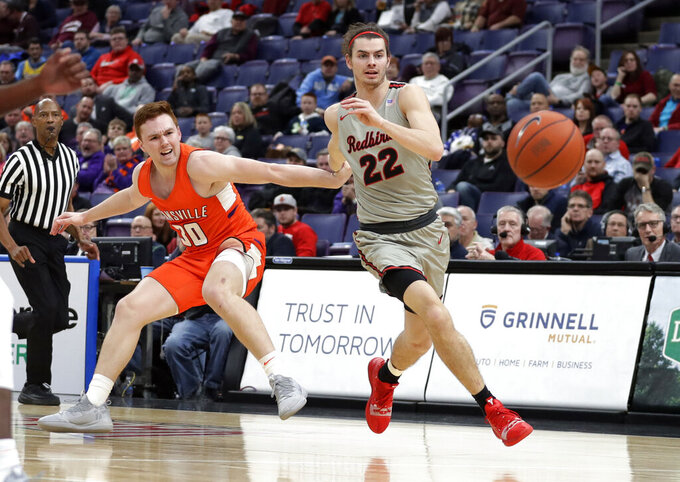Evansville's Noah Frederking (30) and Illinois State's Matt Chastain (22) chase the ball during the first half of an NCAA college basketball game in the first round of the Missouri Valley Conference men's tournament Thursday, March 7, 2019, in St. Louis. (AP Photo/Jeff Roberson)