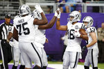 Oakland Raiders wide receiver Tyrell Williams (16) celebrates with teammates after catching an 11-yard touchdown pass during the second half of an NFL football game against the Minnesota Vikings, Sunday, Sept. 22, 2019, in Minneapolis. (AP Photo/Bruce Kluckhohn)