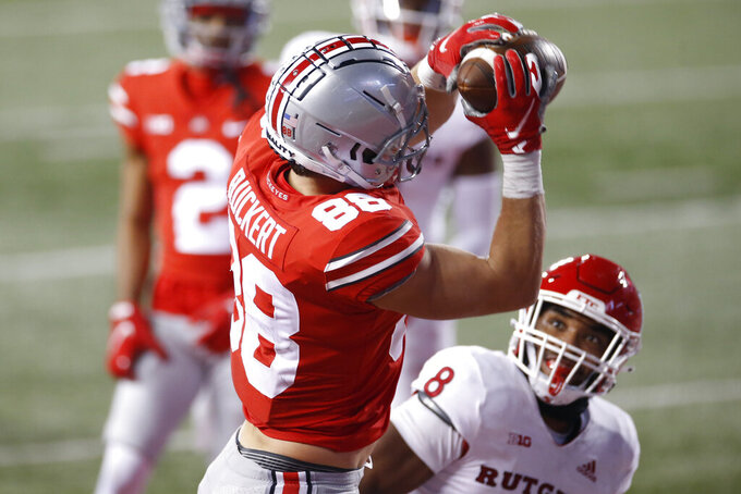 Ohio State tight end Jeremy Ruckert (88) catches a touchdown pass over Rutgers linebacker Tyshon Fogg during the second half of an NCAA college football game Saturday, Nov. 7, 2020, in Columbus, Ohio. Ohio State won 49-27. (AP Photo/Jay LaPrete)