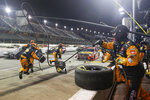 The pit crew for Martin Truex Jr. (19) moves into position during the NASCAR Cup Series auto race Wednesday, May 20, 2020, in Darlington, S.C. (AP Photo/Brynn Anderson)
