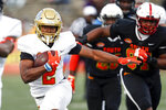 North running back Joshua Kelley of UCLA (2) carries the ball during the second half of the Senior Bowl college football game Saturday, Jan. 25, 2020, in Mobile, Ala. (AP Photo/Butch Dill)