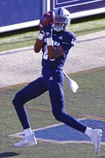 Nevada wide receiver, Jeshua Fixel (20) catches a touchdown pass against Wyoming during the first half of an NCAA football game on Saturday, Oct. 24, 2020, in Reno, Nev. (AP Photo/Lance Iversen)